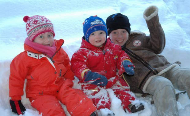 Happy kids in the snow